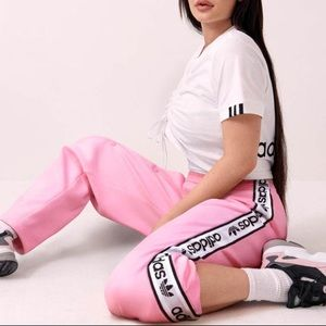 Kylie Jenner adidas track pant with side buttons.